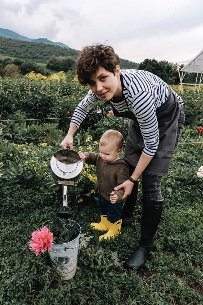 woman gardening with baby